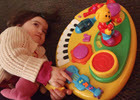 Child With Musical Toy Thumbnail